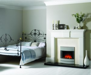 electric fireplace in neutral bedroom with wood surround